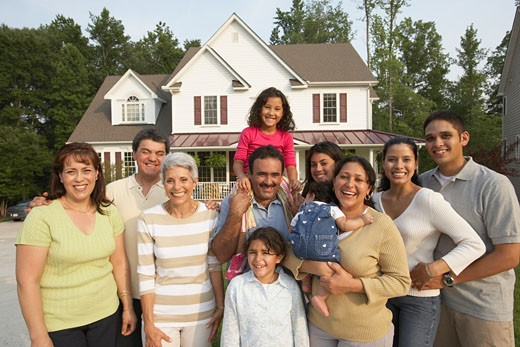 Portrait of multi-generational Hispanic family in front of house : Stock Photo