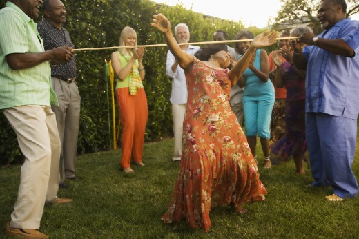 Stock Photo: 1589R-69773 African woman doing the limbo at party