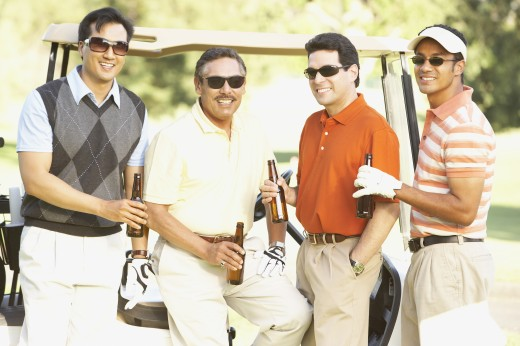 Men drinking beer on golf course : Stock Photo