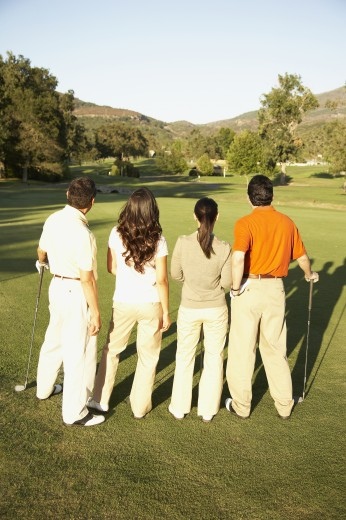 Stock Photo: 1589R-70177 Rear view of two Hispanic couples on golf course