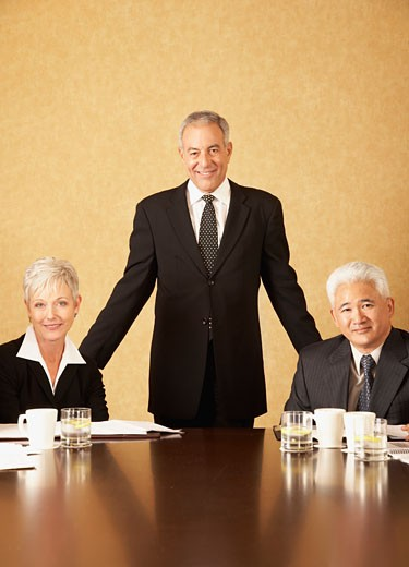 Three senior businesspeople at conference table : Stock Photo