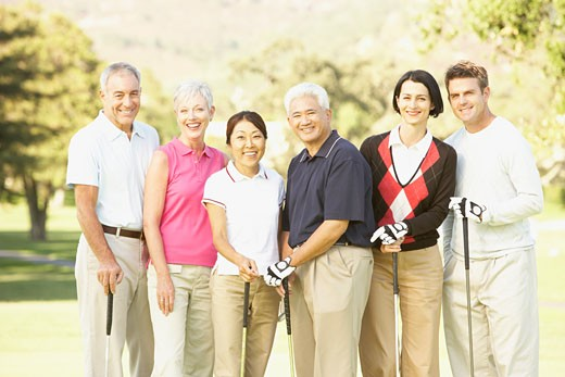 Portrait of three couples on golf course : Stock Photo