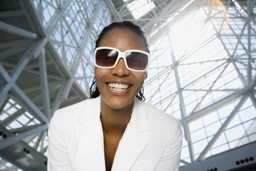Stock Photo: 1589R-70556 Low angle view of African woman wearing sunglasses