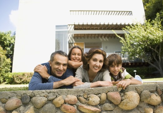 Stock Photo: 1589R-70566 Portrait of family leaning on stone wall
