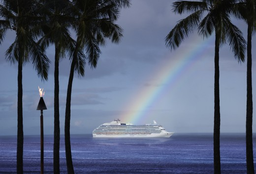 Stock Photo: 1589R-70776 Cruise ship on horizon at end of rainbow