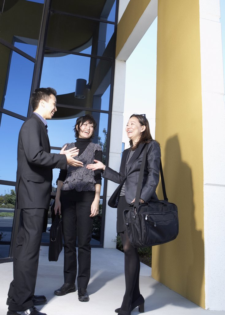 Asian businesspeople talking outdoors : Stock Photo