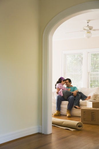 Stock Photo: 1589R-70838 Hispanic couple hugging in new home