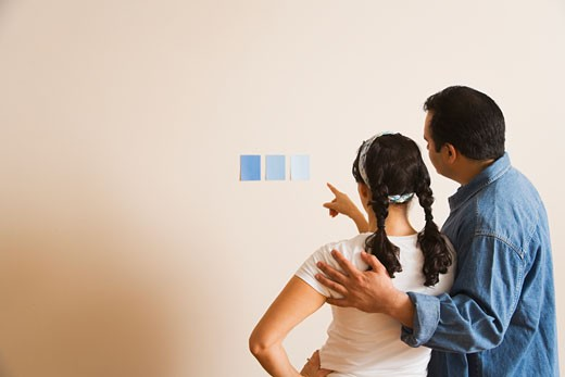 Stock Photo: 1589R-70873 Hispanic couple looking at paint swatches