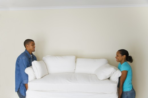 African couple carrying sofa : Stock Photo