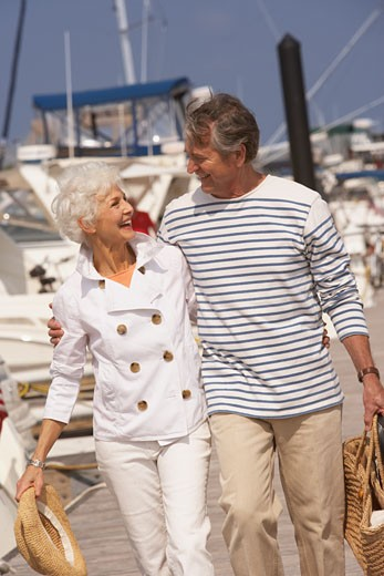Stock Photo: 1589R-70898 Senior couple strolling at marina