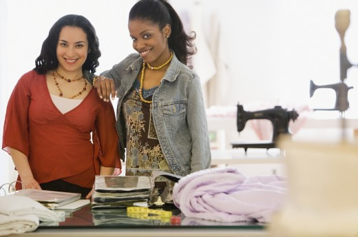 Two women smiling in design workshop : Stock Photo