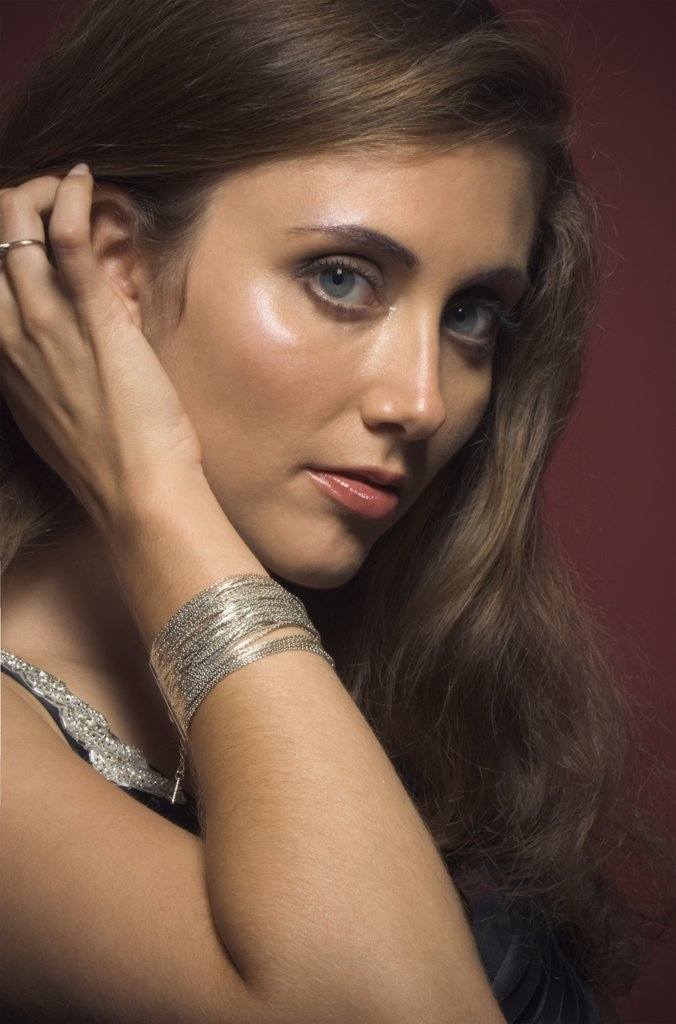 Stock Photo: 1589R-71065 Close up of Hispanic woman with hand in hair