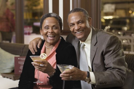 Stock Photo: 1589R-71094 Senior African couple drinking cocktails