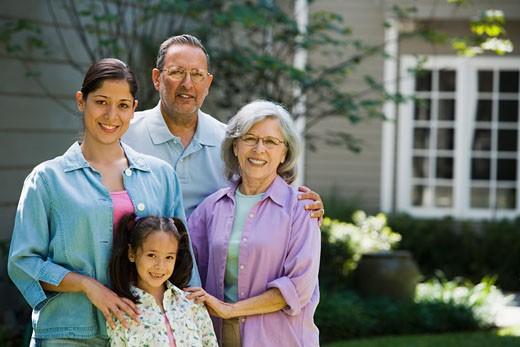 Stock Photo: 1589R-71144 Hispanic family smiling in backyard