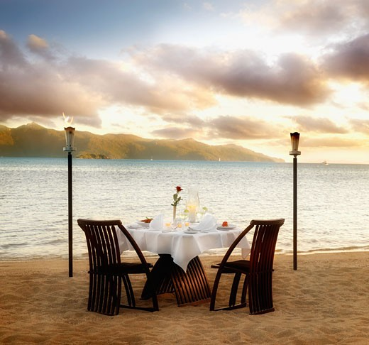 Stock Photo: 1589R-71308 Table set for two at beach