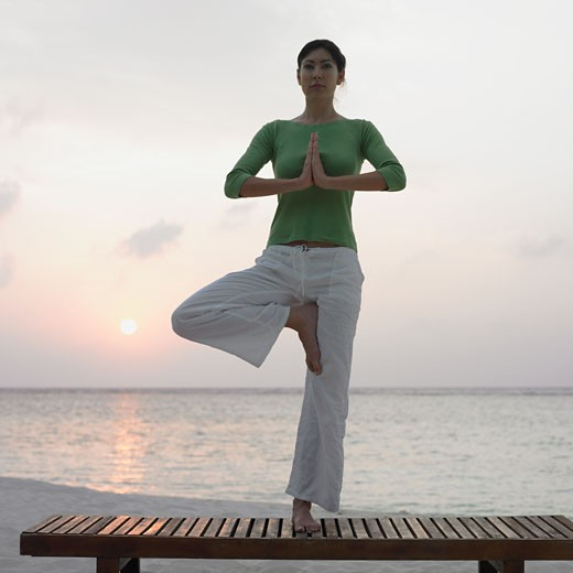 Stock Photo: 1589R-71445 Woman practicing yoga at beach