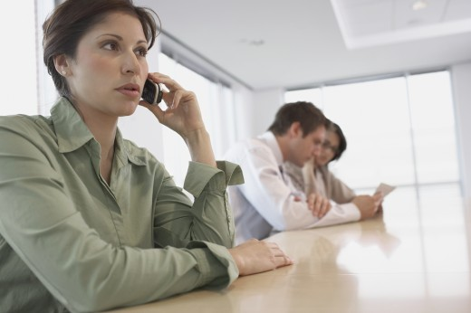 Stock Photo: 1589R-71497 Hispanic businesswoman talking on cell phone