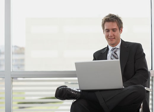 Stock Photo: 1589R-71546 Businessman working on laptop