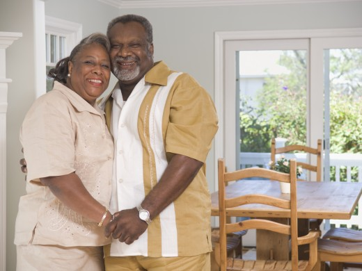 Stock Photo: 1589R-71735 Senior African couple hugging indoors
