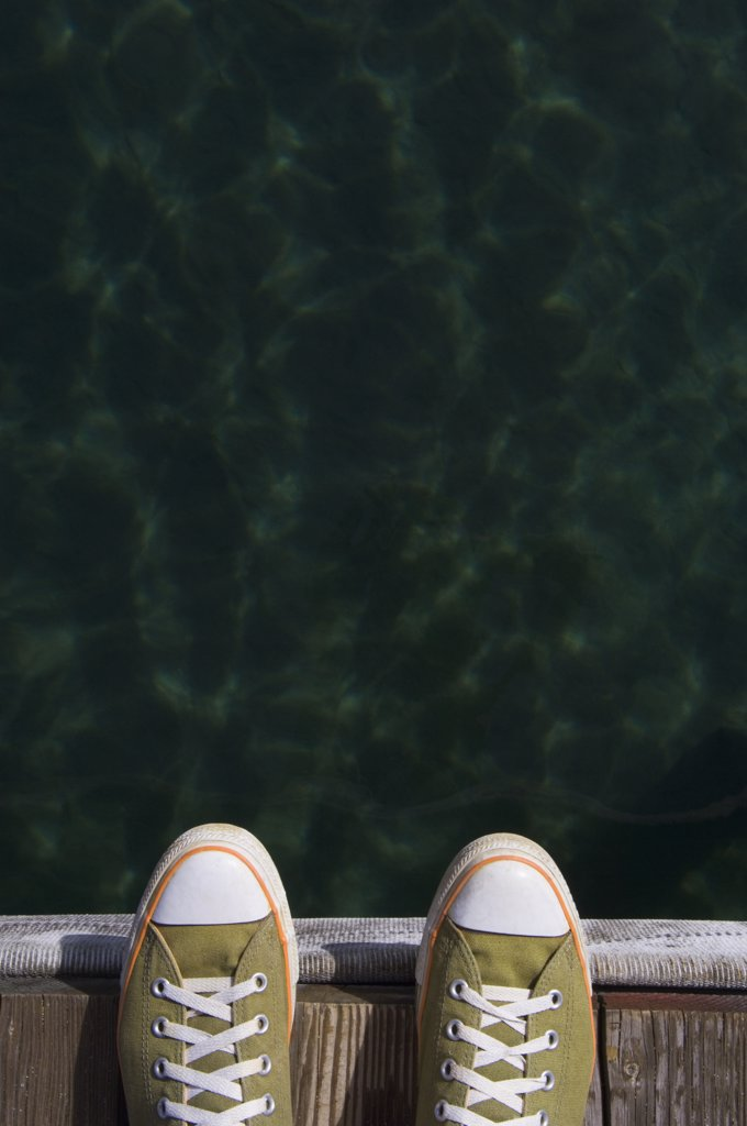 Stock Photo: 1589R-71800 Sneakers on dock over water
