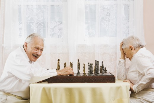 Stock Photo: 1589R-71859 Senior couple playing chess