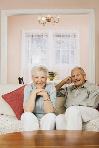 Senior couple sitting on sofa : Stock Photo
