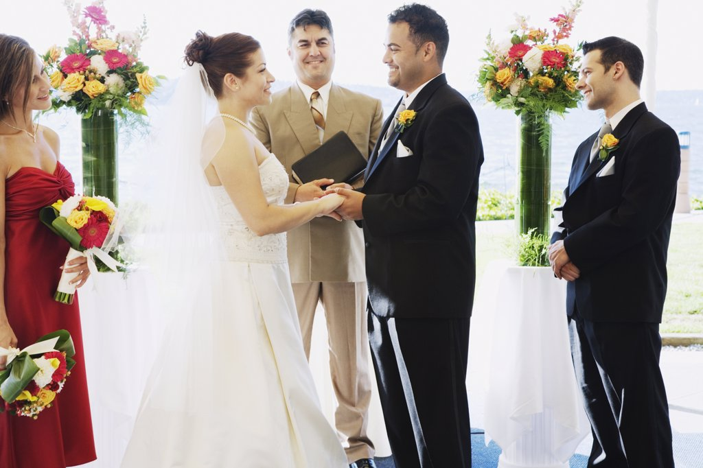 Stock Photo: 1589R-72122 Multi-ethnic couple getting married
