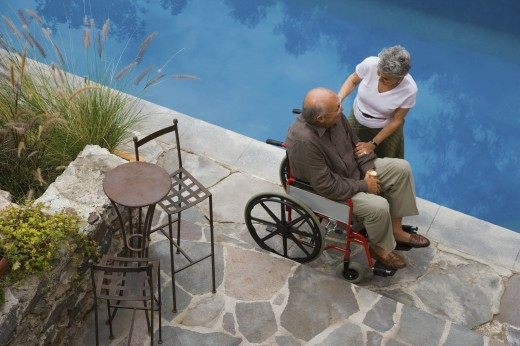 Stock Photo: 1589R-72194 Senior woman smiling at husband in wheelchair