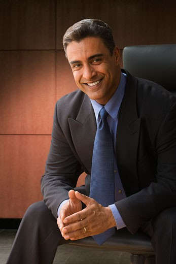 Stock Photo: 1589R-72360 Hispanic businessman in office chair