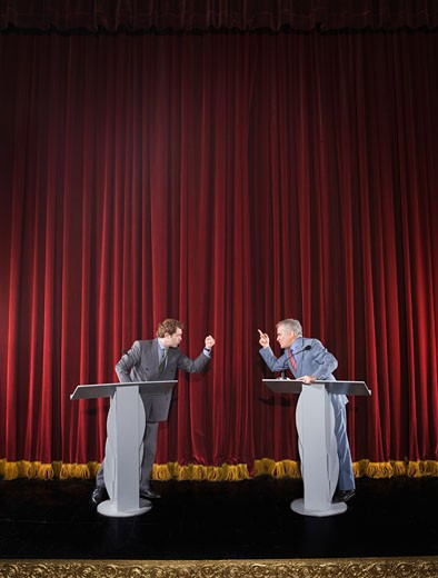 Politicians having debate on stage : Stock Photo