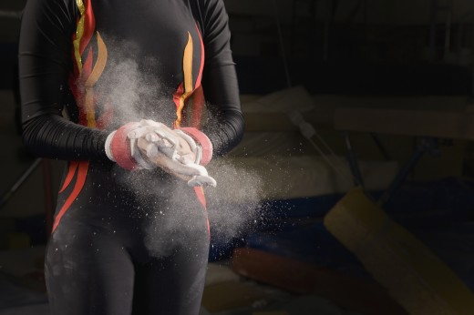 Stock Photo: 1589R-72819 Hispanic female gymnast chalking hands
