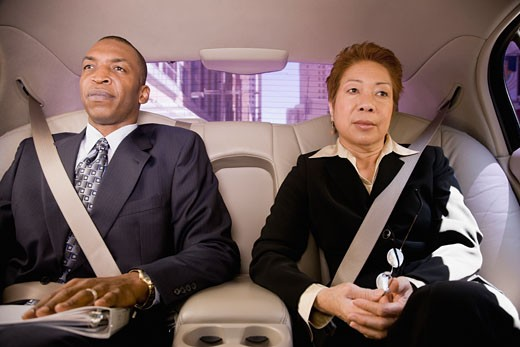 Stock Photo: 1589R-72995 Business people in back seat of car