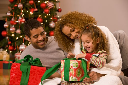 Stock Photo: 1589R-73463 Mixed race family opening Christmas gifts