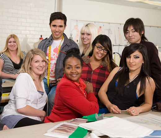 Stock Photo: 1589R-73585 Portrait of fashion design students in classroom