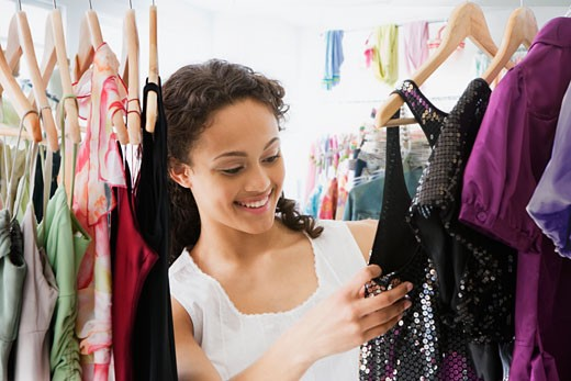 Stock Photo: 1589R-74530 Mixed race teenage girl in dress shop