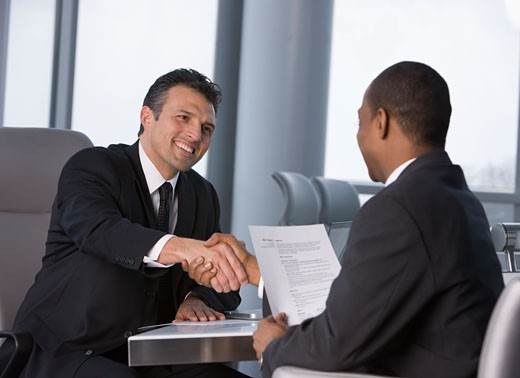 Stock Photo: 1589R-74683 Businessmen shaking hands