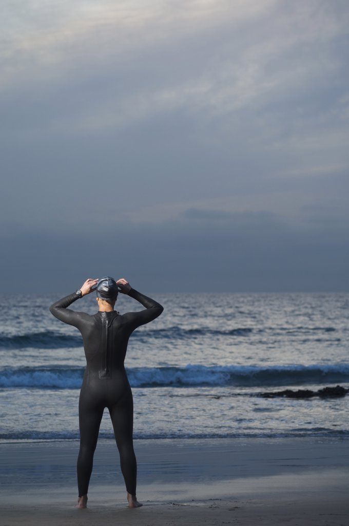 Stock Photo: 1589R-74722 Hispanic woman in wetsuit on beach