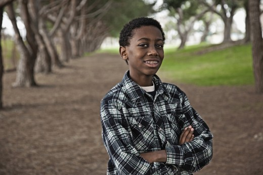 African boy standing in park : Stock Photo