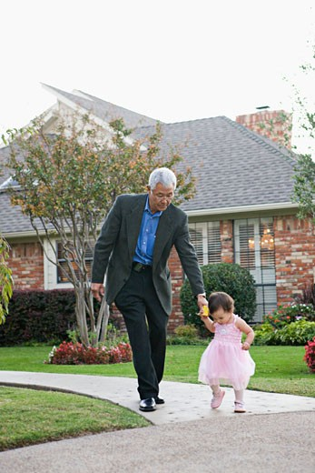 Burmese grandfather holding hands with granddaughter : Stock Photo