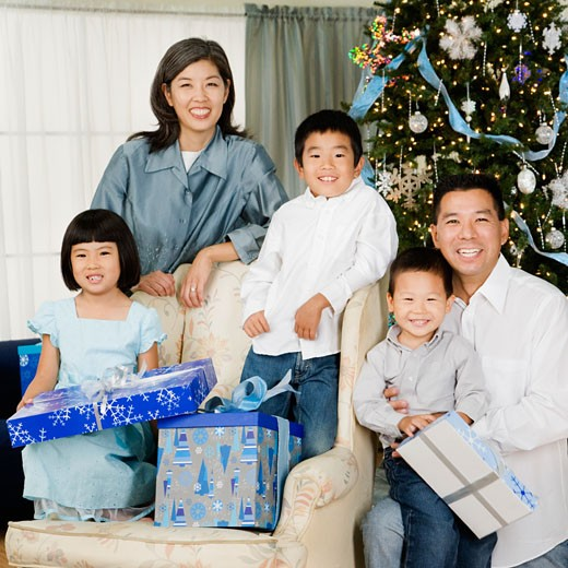 Asian family in living room with Christmas gifts : Stock Photo