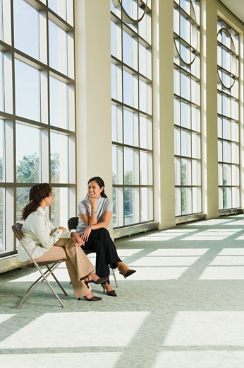 Stock Photo: 1589R-75782 Businesswomen talking in office lobby