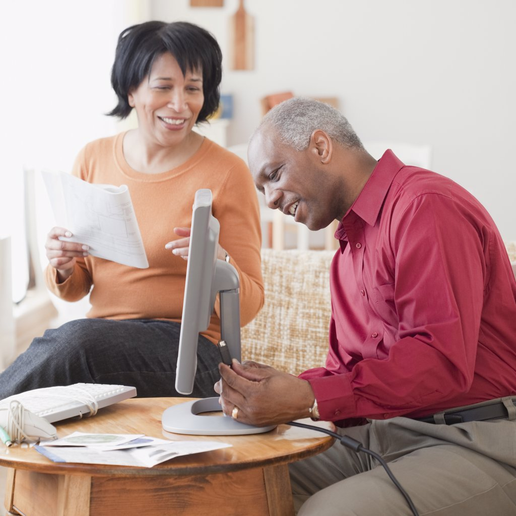 Stock Photo: 1589R-75841 African couple assembling computer