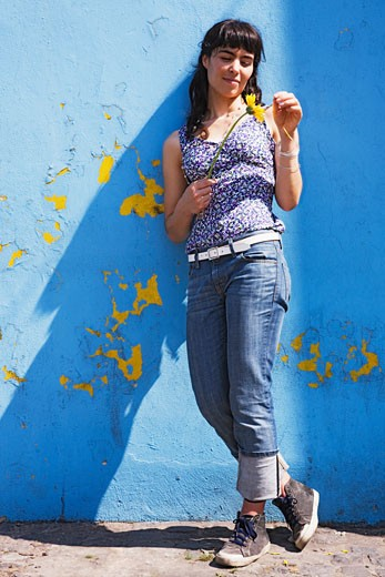 Stock Photo: 1589R-75926 Hispanic woman plucking flower petals