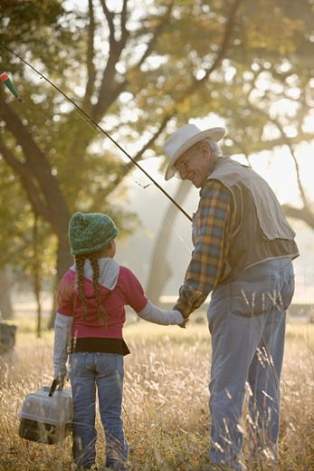 Hispanic man going fishing with granddaughter : Stock Photo