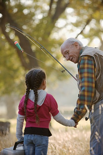 Stock Photo: 1589R-76077 Hispanic man going fishing with granddaughter