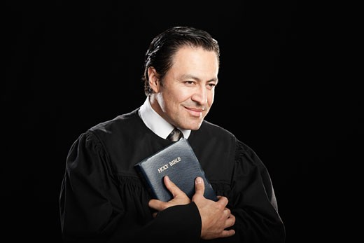 Hispanic pastor holding Bible : Stock Photo