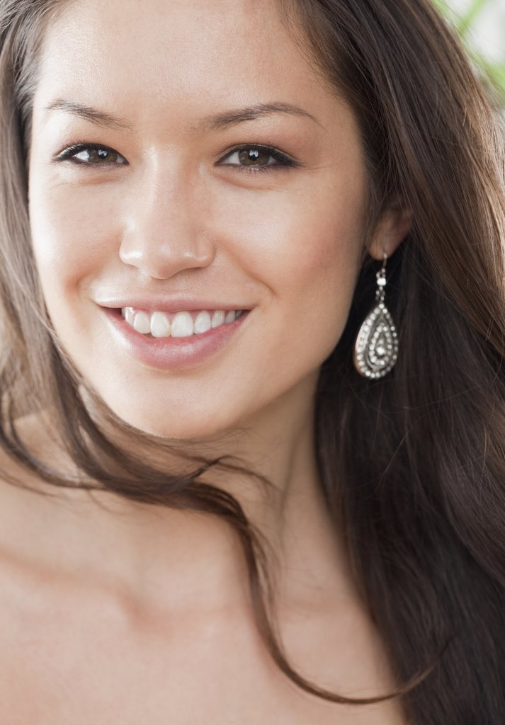 Stock Photo: 1589R-76677 Mixed race woman smiling