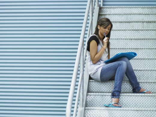 Woman reading on stairway : Stock Photo