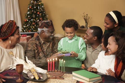 Stock Photo: 1589R-77322 Multi-generation family celebrating Kwanzaa
