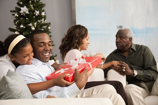 Stock Photo: 1589R-77342 Multi-generation family celebrating Christmas